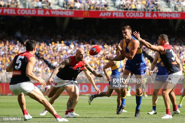 Scott Lycett of the Eagles handballs during the AFL Preliminary Final match between the West Coast Eagles and the Melbourne Demons on September 22...