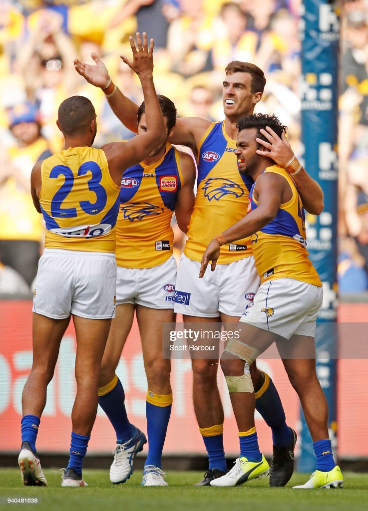 Scott Lycett of the Eagles is congratulated by his teammates after kicking a goal during the round two AFL match between the Western Bulldogs and the West Coast Eagles at Etihad Stadium on April 1, 2018 in Melbourne, Australia.
