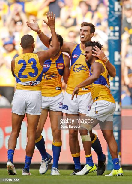 Scott Lycett of the Eagles is congratulated by his teammates after kicking a goal during the round two AFL match between the Western Bulldogs and the...