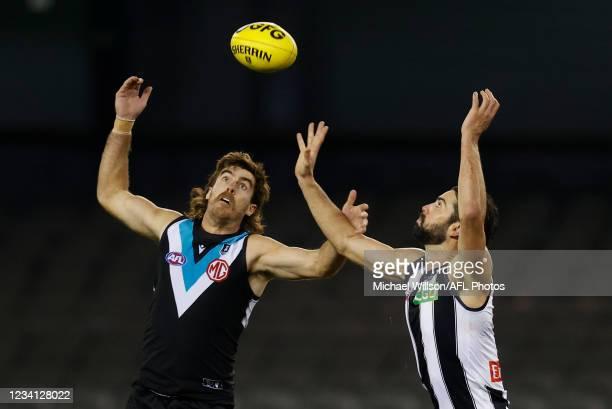 Scott Lycett of the Power and Brodie Grundy of the Magpies compete for the ball during the 2021 AFL Round 19 match between the Port Adelaide Power...