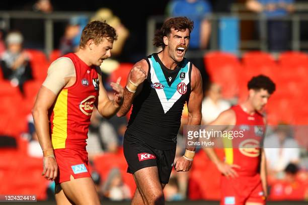 Scott Lycett of the Power celebrates a goal during the round 14 AFL match between the Gold Coast Suns and the Port Adelaide Power at Metricon Stadium...
