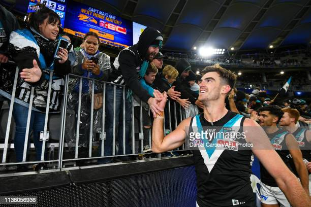 Scott Lycett of the Power celebrates with the fans during the 2019 AFL round 05 match between the West Coast Eagles and the Port Adelaide Power at...