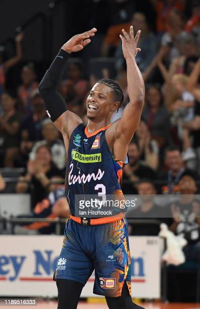 Scott Machado of the Taipans celebrates after a team mate scores a three point shot during the round 8 NBL match between the Cairns Taipans and the...