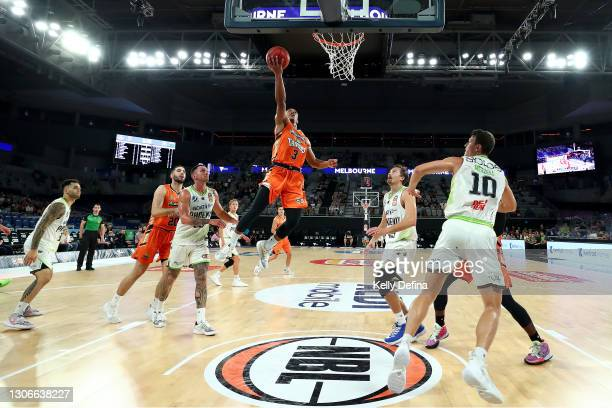 Scott Machado of the Taipans drives to the basket during the NBL Cup match between the Cairns Taipans and the South East Melbourne Phoenix at John...