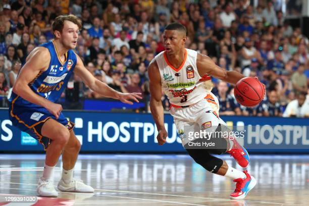 Scott Machado of the Taipans drives to the basket during the round three NBL match between the Brisbane Bullets and the Cairns Taipans at Nissan...