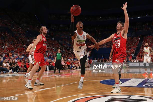 Scott Machado of the Taipans puts a shot up during game one of the NBL Semi Finals Series between the Perth Wildcats and the Cairns Taipans at RAC...