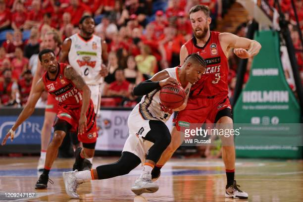 Scott Machado of the Taipans runs into the defense from Nick Kay of the Wildcats during game one of the NBL Semi Finals Series between the Perth...