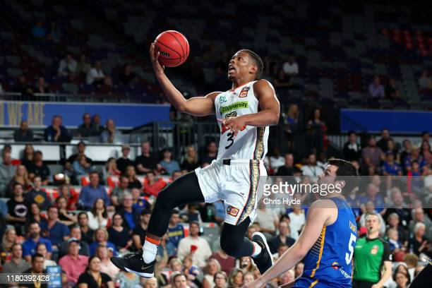 Scott Machado of the Taipans shoots during the round two NBL match between the Brisbane Bullets and the Cairns Taipans at Queensland State Netball...