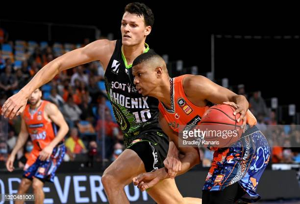 Scott Machado of the Taipans takes on the defence of Yannick Wetzell of the Phoenix during the round 20 NBL match between South East Melbourne...