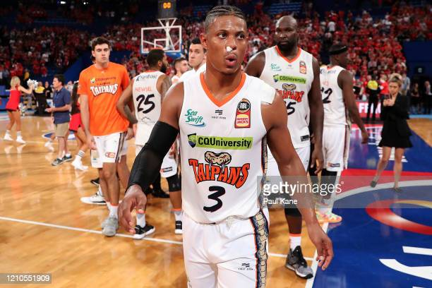 Scott Machado of the Taipans walks from the court after being defeated during game three of the NBL Semi Final Series between the Perth Wildcats and...