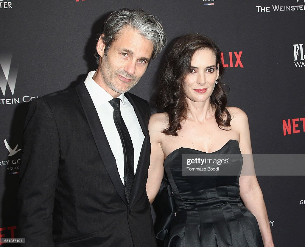 Scott Mackinlay Hahn (L) and actress Winona Ryder attend The Weinstein Company and Netflix Golden Globe Party, presented with FIJI Water, Grey Goose Vodka, Lindt Chocolate, and Moroccanoil at The Beverly Hilton Hotel on January 8, 2017 in Beverly Hills, California.