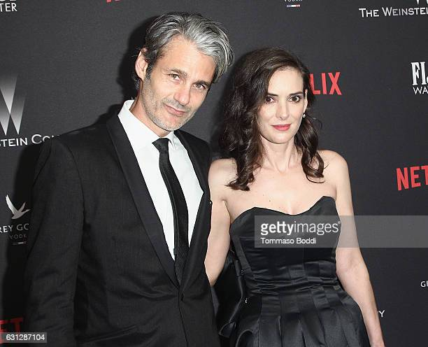 Scott Mackinlay Hahn and actress Winona Ryder attend The Weinstein Company and Netflix Golden Globe Party presented with FIJI Water Grey Goose Vodka...