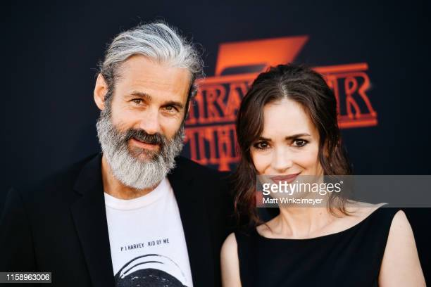 "Scott Mackinlay Hahn and Winona Ryder attend the premiere of Netflix's ""Stranger Things"" Season 3 on June 28, 2019 in Santa Monica, California."