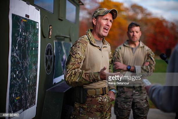 Scott Malkowski Task Force Commander US Marshals Service Special Operations Group talks with members of the media while he explains how Eric Matthew...