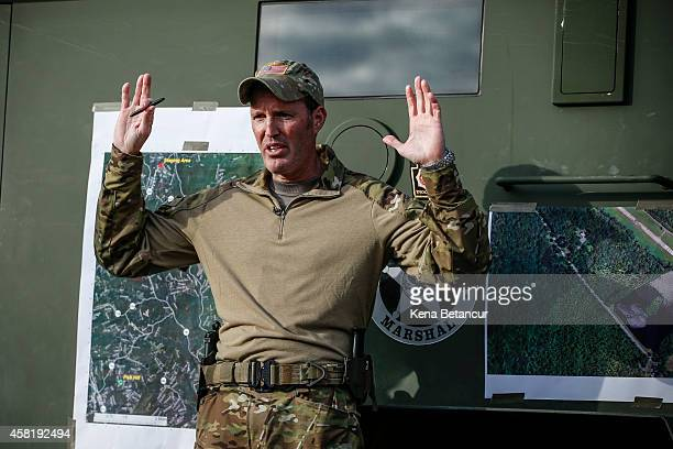 Scott Malkowski Task Force Commander US Marshals Service Special Operations Group gestures as he explain how Eric Matthew reacts when he was captured...