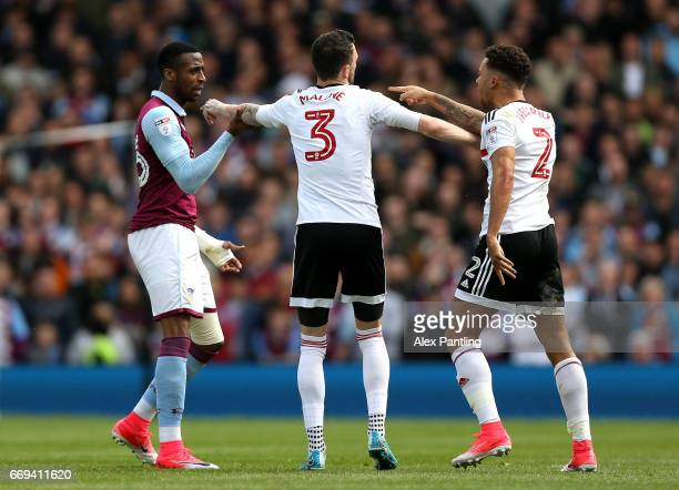 Scott Malone of Fulham seperate Jonathan Kodija of Aston Villa and Nathan Baker of Aston Villa is the build up to a red card for Jonathan Kodija of...