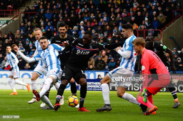Scott Malone of Huddersfield Town tackles Jeffrey Schlupp of Crystal Palace during the Premier League match between Huddersfield Town and Crystal...