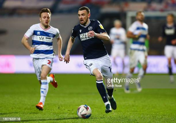 Scott Malone of Millwall FC and Todd Kane of Queens Park Rangers battle for the ball during the Sky Bet Championship match between Queens Park...