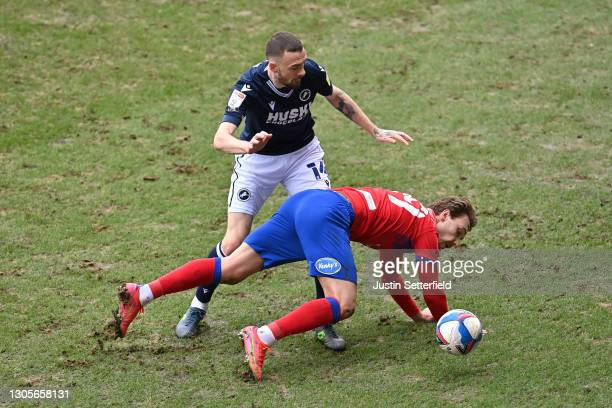 Scott Malone of Millwall FC and Tom Trybull of Blackburn Rovers battle for the ball during the Sky Bet Championship match between Millwall and...