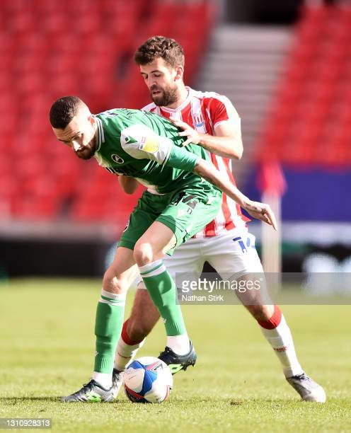 Scott Malone of Millwall FC battles for possession with Tommy Smith of Stoke City during the Sky Bet Championship match between Stoke City and...