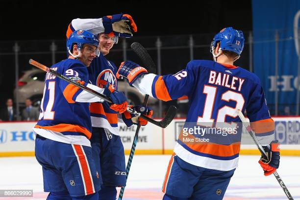 Scott Mayfield of the New York Islanders celebrates his third period goal with teammates John Tavares and Josh Bailey against the Arizona Coyotes at...