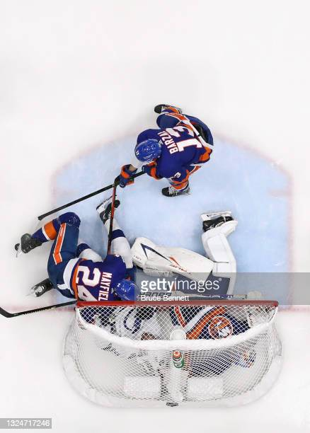 Scott Mayfield of the New York Islanders checks Brayden Point of the Tampa Bay Lightning into Semyon Varlamov in Game Four of the Stanley Cup...
