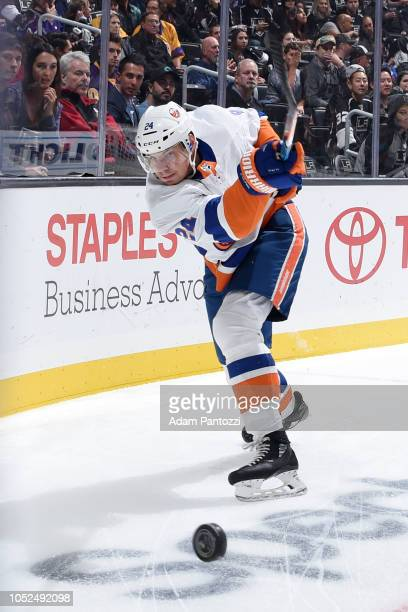 Scott Mayfield of the New York Islanders clears the puck during the first period of the game against the Los Angeles Kings at STAPLES Center on...