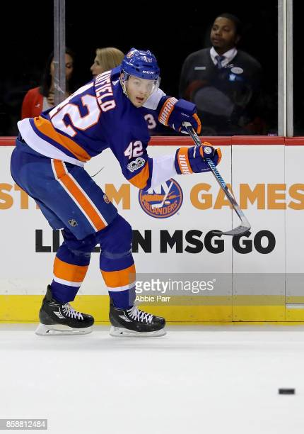 Scott Mayfield of the New York Islanders passes the puck against the Buffalo Sabres in the first period at Barclays Center on October 7 2017 in the...