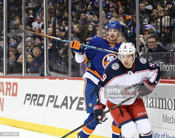 Scott Mayfield of the New York Islanders skates against Artemi Panarin of the Columbus Blue Jackets during the second period at Barclays Center on...