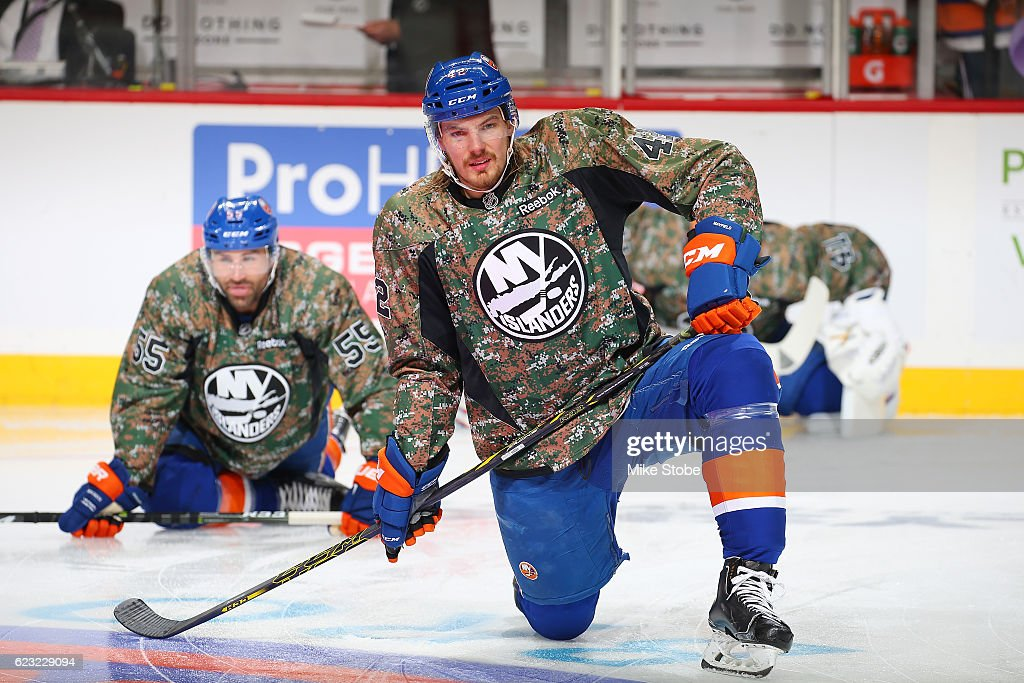 finest selection c85c8 7d4a7 Scott Mayfield of the New York Islanders sports a camo warm ...