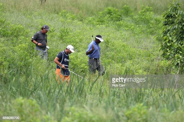 Scott McCarron and Vijay Singh look for McCarron's lost ball in the rough on the seventh hole Round 3 of the Senior PGA Championship at Trump...