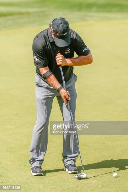 Scott McCarron attepmts a birdie putt on eighteen during the final round of the American Family Insurance Championship Champions Tour golf tournament...
