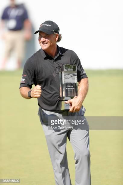 Scott McCarron celebrates winning the American Family Insurance Championship Champions Tour golf tournament on June 24 2018 at University Ridge Golf...