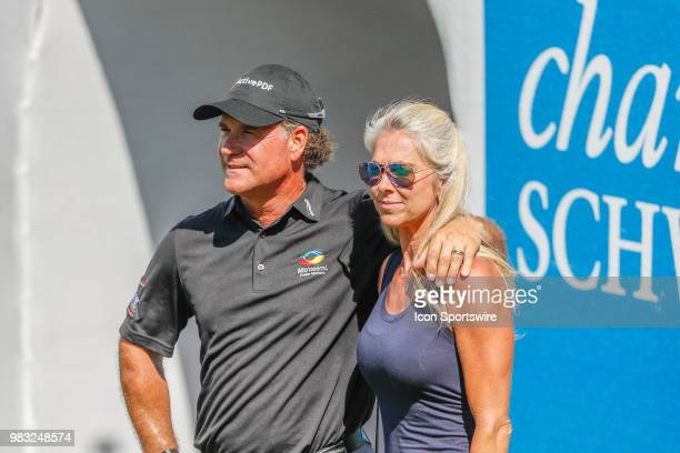 Scott McCarron celebrates with his wife Jenny after winning the American Family Insurance Championship Champions Tour golf tournament on June 24 2018...