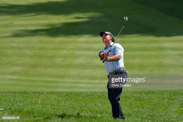 Scott McCarron chips to the 5th green during the final round of the PGA TOUR Champions DICK'S Sporting Goods Open at EnJoie Golf Course on August 20...