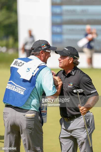 Scott McCarron is congratulated by his caddy after winning the American Family Insurance Championship Champions Tour golf tournament on June 24 2018...