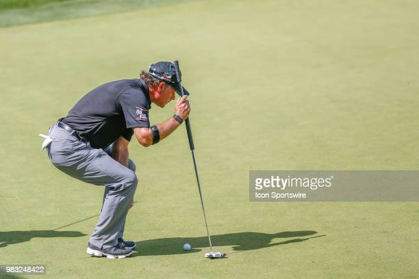 Scott McCarron lines up his putt on eighteen during the final round of the American Family Insurance Championship Champions Tour golf tournament on...