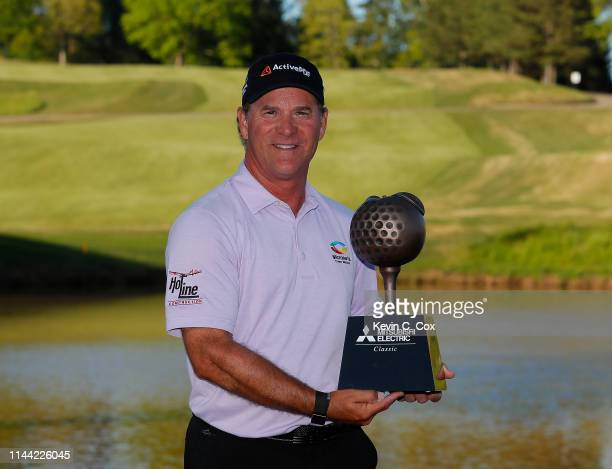 Scott McCarron poses with the trophy after winning the Mitsubishi Electric Classic at TPC Sugarloaf on April 21 2019 in Duluth Georgia