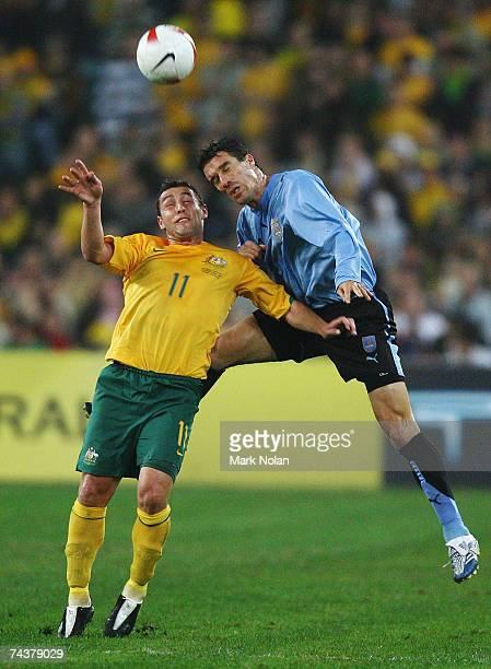 Scott McDonald of Australia and Andres Scotti of Uruguay compete for possession during the International Friendly match between Australia and Uruguay...