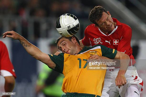 Scott McDonald of Australia battles for the ball with Stephan Lichtsteiner of Switzerland during an International friendly match between Switzerland...