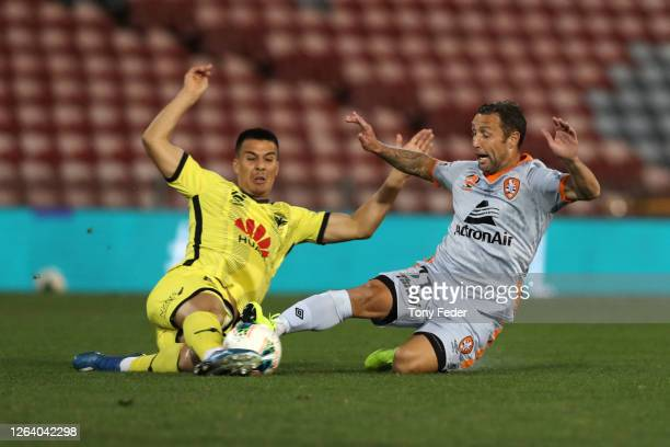 Scott McDonald of Brisbane Roar contests the ball with his Phoenix opponent during the round 28 A-League match between the Wellington Phoenix and the...