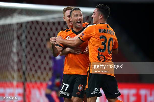 Scott McDonald of the Roar celebrates a goal with team mates during the round 22 ALeague match between the Brisbane Roar and the Western Sydney...