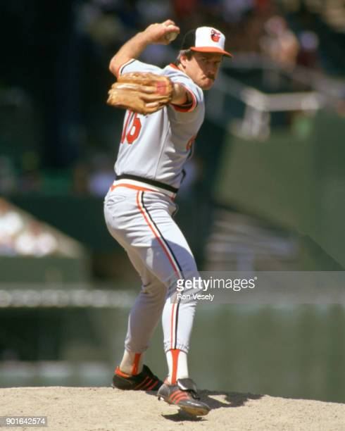 Scott McGregor of the Baltimore Orioles pitches during an MLB game versus the Chicago White Sox at Comiskey Park in Chicago Illinois during the 1985...