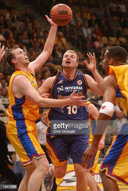 Scott McGregor of the Razorbacks contests the ball with Paul Rees of the 36ers during the NBL round 1 match between the West Sydney Razorbacks and...