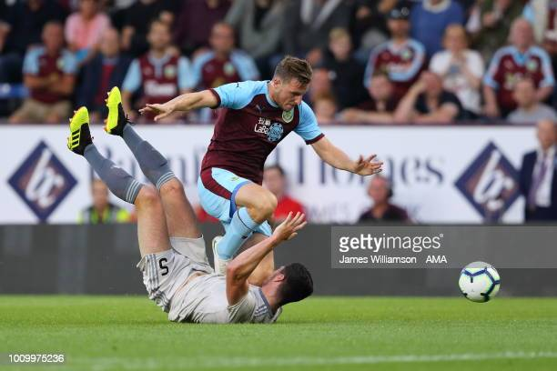 Scott McKenna of Aberdeen and Chris Wood of Burnley tangle during the UEFA Europa League Second Qualifying Round 2nd Leg match between Burnley and...