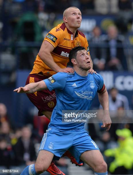 Scott McKenna of Aberdeen is challenged Curtis Main of Motherwell during the Scottish Cup Semi Final match between Motherwell and Aberdeen at Hampden...