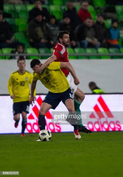 Scott McKenna of Scotland competes for the ball with Daniel Böde of Hungary during the friendly match between Hungary and Scotland at Groupama Arena...