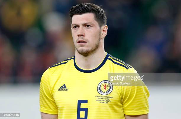 Scott McKenna of Scotland listens to the anthem during the International Friendly match between Hungary and Scotland at Groupama Arena on March 27...