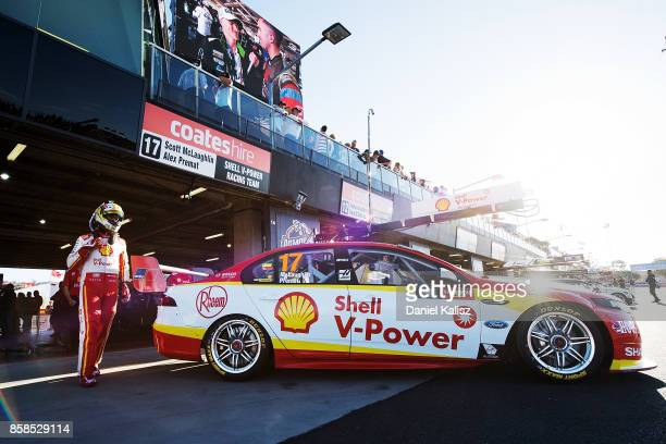 Scott McLaughlin driver of the Shell VPower Racing Team Ford Falcon FGX climbs aboard his car during the top ten shootout ahead of this weekend's...