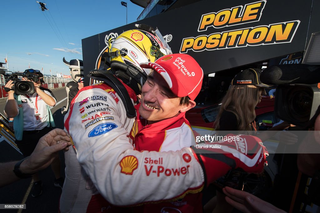 Scott McLaughlin driver of the #17 Shell V-Power Racing Team Ford Falcon FGX celebrates with Ludo Lacroix engineering director at Shell V-Power Racing Team after taking pole position during the top ten shootout ahead of this weekend's Bathurst 1000, which is part of the Supercars Championship at Mount Panorama on October 7, 2017 in Bathurst, Australia.